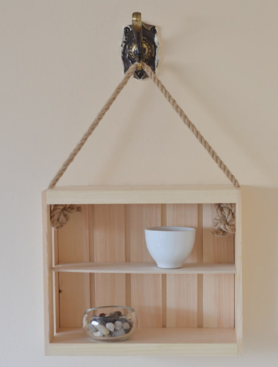 A simple rope and crate shelf