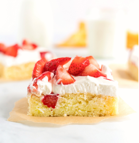 a delicious, moist and tender slab strawberry shortcake smothered in homemade whipped cream and fresh sliced strawberries