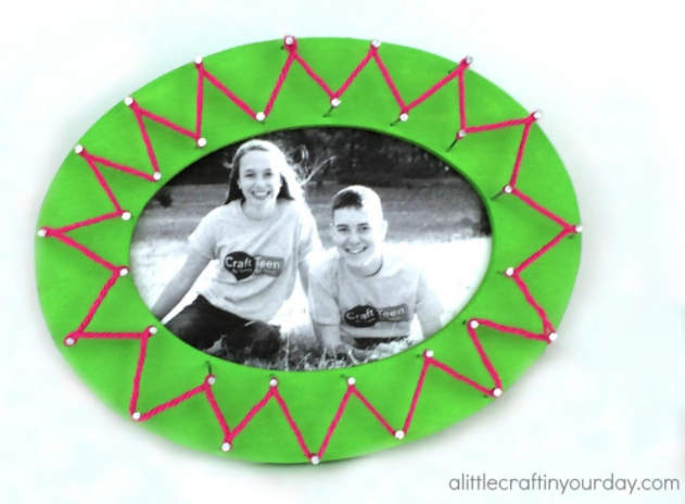 A string art frame with a photo of Tanner and Courtney