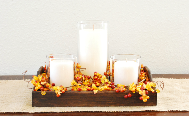 Fall candle with berry picks and garland centerpiece