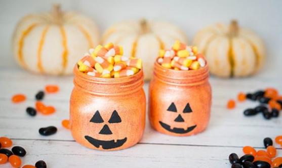 Glittery pumpkin jars full of  Halloween candy cones