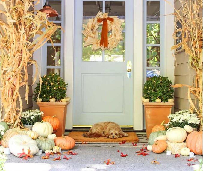 neutral fall porch decor with pumpkins and cornstalks holiday craft