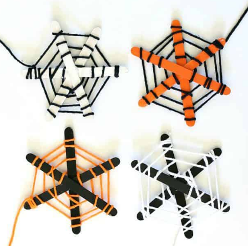 Popsicle sticks and yarn spider webs
