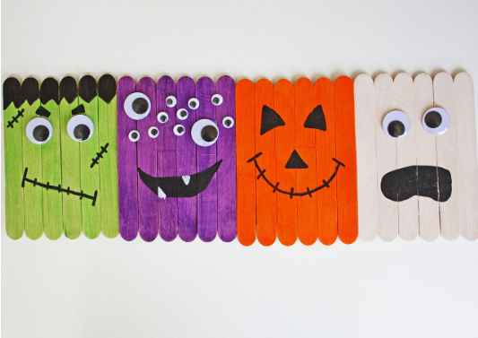 a ghost, monster, Jack O' Lantern and Frankenstein popsicle stick