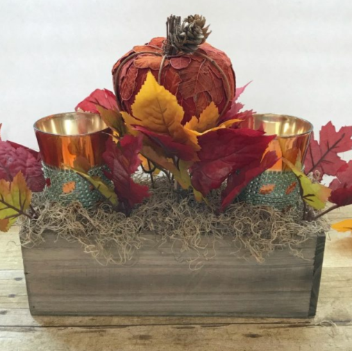 cute little leafy pumpkin with fall leaves and candles centerpiece