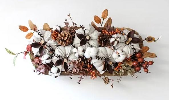 Oatmeal linen pumpkins with leaves, acorns, pinecones centerpiece