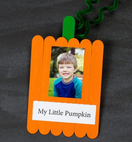Popsicle stick pumpkin keepsake with a cute photo of a boy on it and a text saying My Little Pumpkin