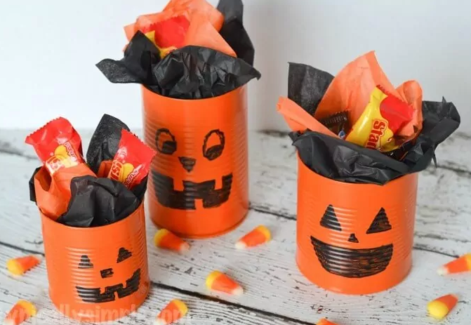 Tin can pumpkins with Halloween treats inside