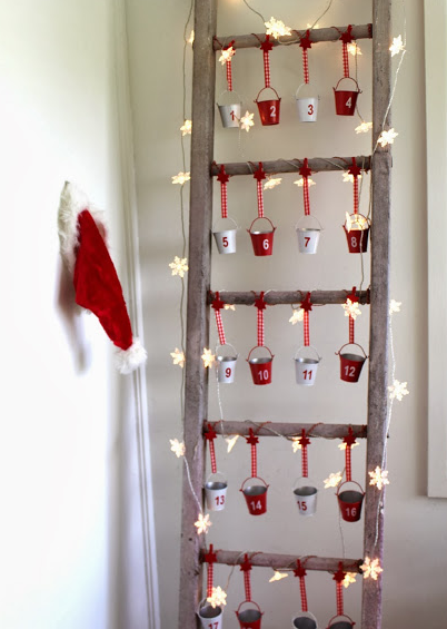 advent calendar on a vintage ladder for christmas holiday craft