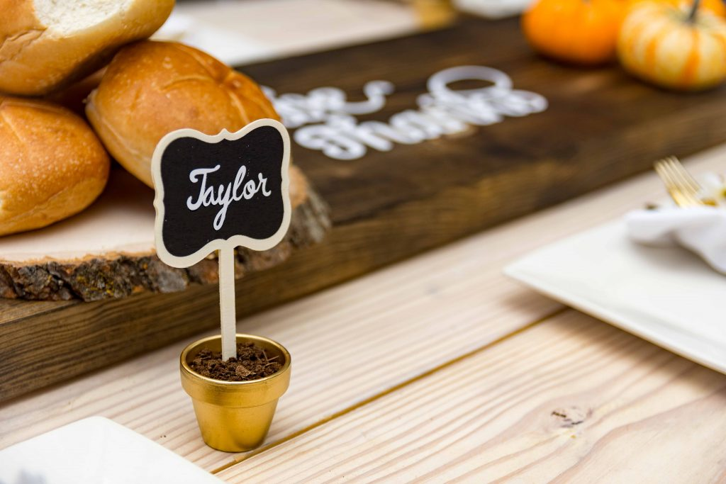 Chalkboard place card with text name Taylor on it