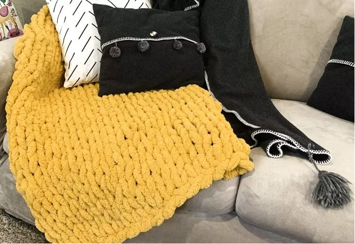 Hand knitted yellow blanket
