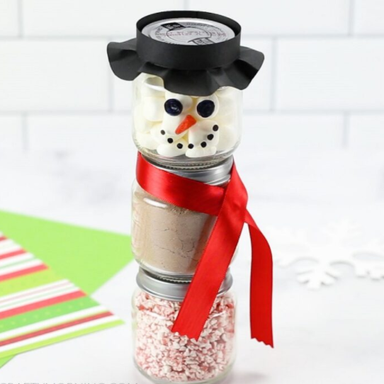 A hot cocoa ingredients put on a snowman like jars
