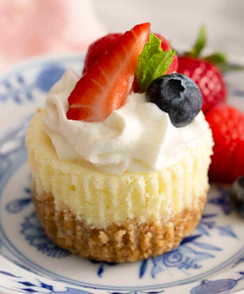 A smooth and creamy banana cream cheesecake recipe topped with bavarian and fresh fruits