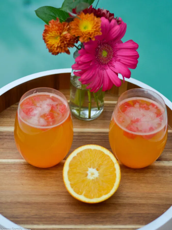 A couple of orange watermelon mocktails on a glasses