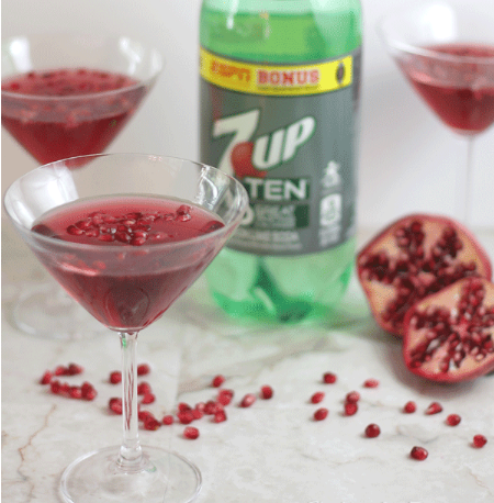 Pomegranate martini mocktails on a glass with pomegranate seeds on them
