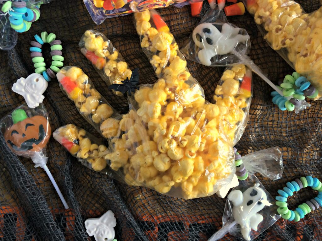Popcorn witch hand and Halloween candies