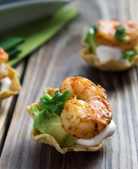 Shrimp Taco Bites, bite-sized appetizers filled with avocado, shrimp and a sour cream sauce