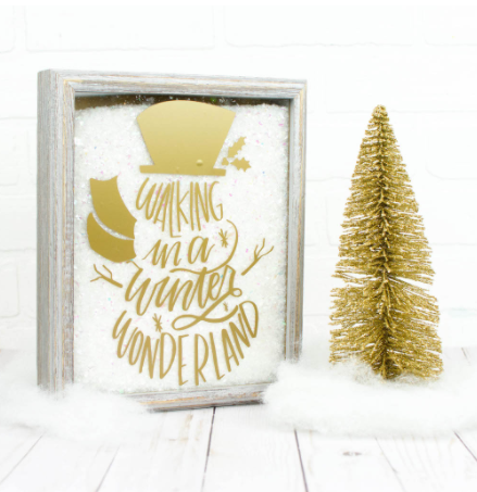 Snow filled Christmas shadow box with a text saying Walking in a winter wonderland