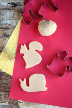 Sugar cookie homemade playdough shaped like a snail and a rabbit