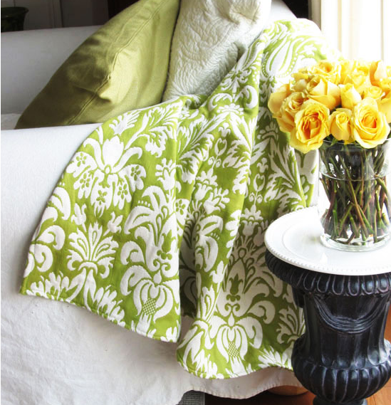 Fabric throw blanket that has a classic flower pattern on it
