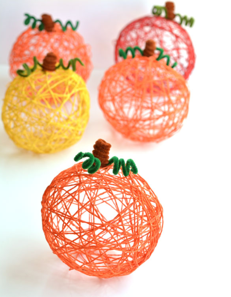 how to make yarn pumpkins using balloons fall holiday craft for kids