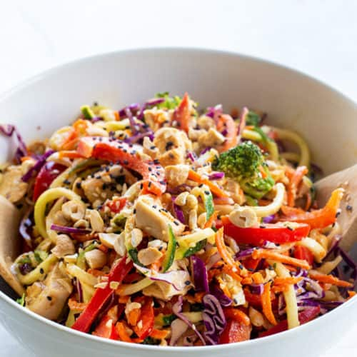 A bowl of Thai Chicken Veggie noodle salad with creamy peanut dressing