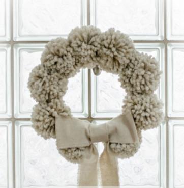 A cute anthropologie inspired pom pom wreath