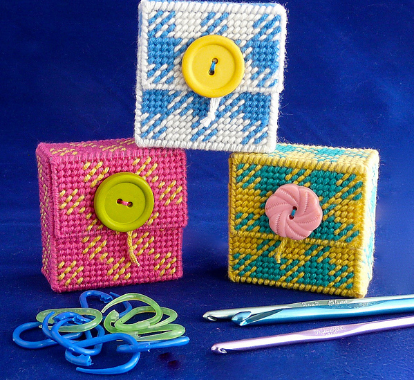 A stitched marker case from plastic canvas using cottonish yarn