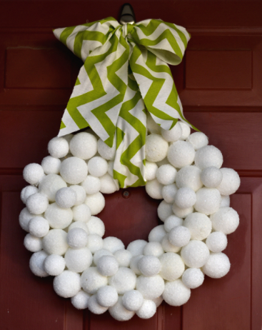 A winter snowball wreath outdoor decor for the holiday