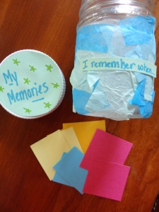 jar decorated with tissue paper and 100 papers in it with a memory written on each one