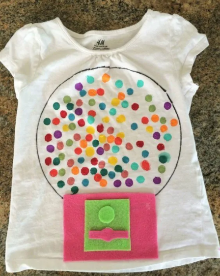 tshirt with felt gumball machine and 100 gumballs painted on