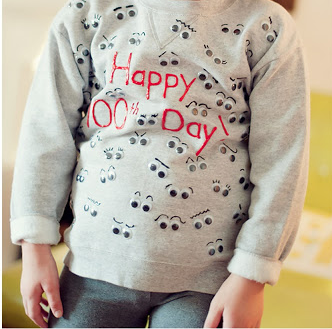 sweatshirt with Happy 100th Day painted on and 100 googly eyes