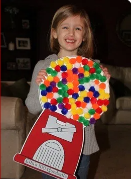 paper and cardstock gumball machine with 100 pompoms as gumballs