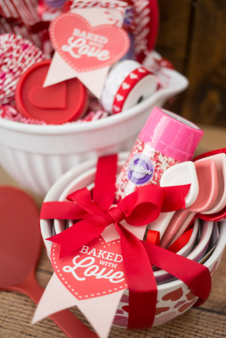 mixing bowl filled with baking supplies and a tag saying Baked with Love