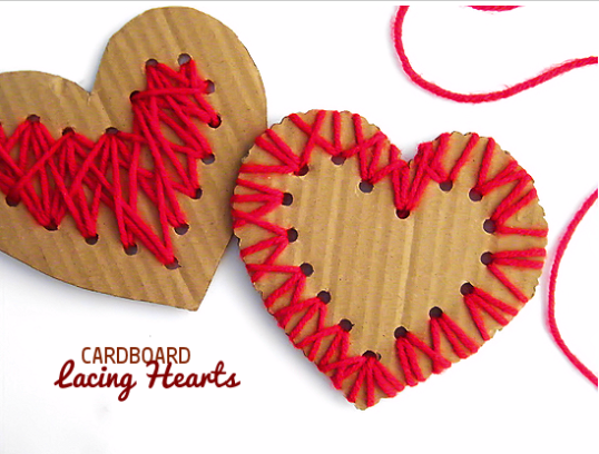Two heart shape cardboard 1 with a red yarn around the edge and the other one is with a red yarn on the middle