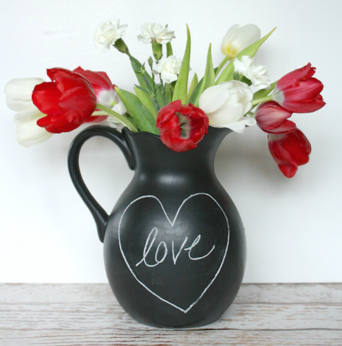 Chalkboard pitcher with the word love inside a heart