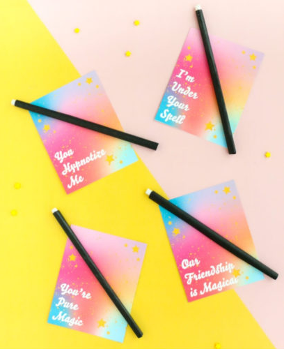 valentines with pencils added to look like magic wands and text saying I'm under your spell