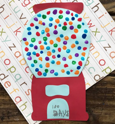 paper gumball machine with 100 thumbprints as the gumballs