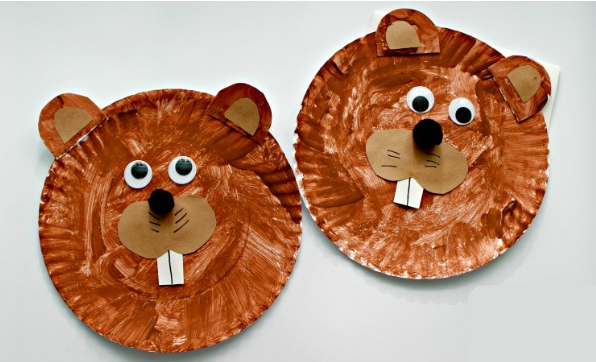 groundhog faces made from painted paper plates with construction paper features