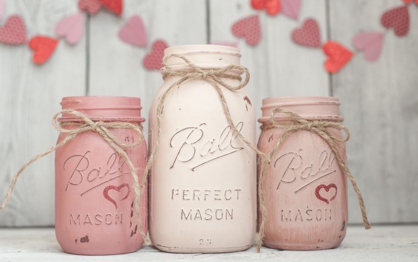 Painted mason jars with a ribbon