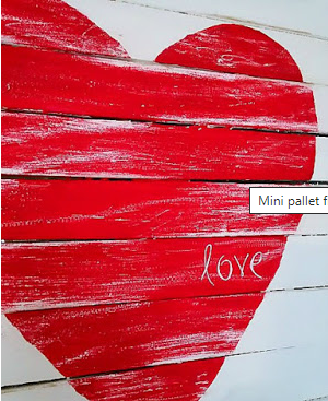 Farmhouse style heart shape painted red with the word love