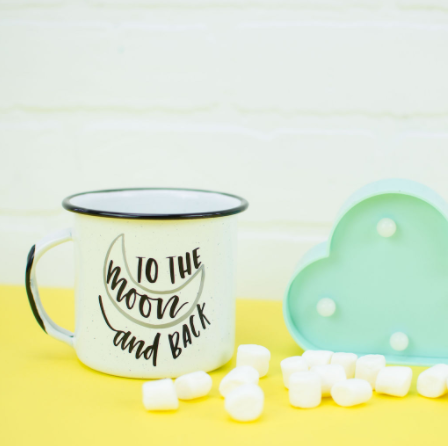 coffee mug that says to the moon and back on it