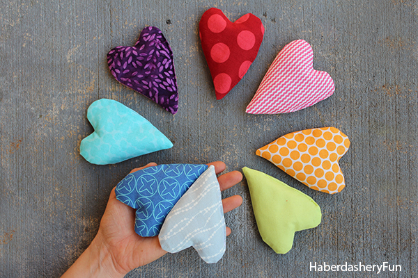 Various designs of a mini heart shaped hand warmers