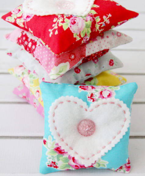 felt and fabric sachets with hearts and buttons on them