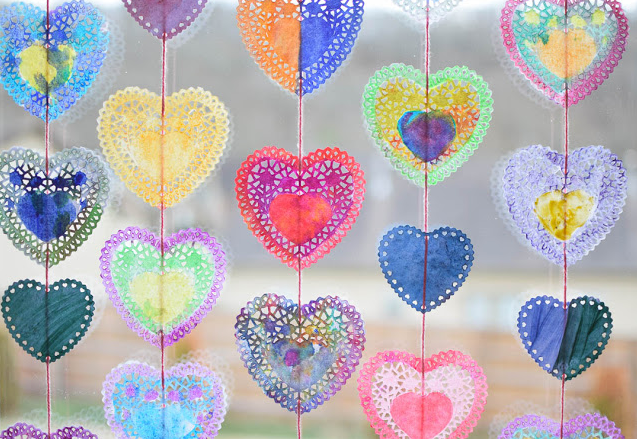 Heart shape doilies painted in different lovely colors string onto a garland