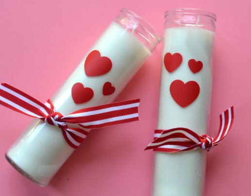 DIY Valentine's Day candles with hearts and bows on them