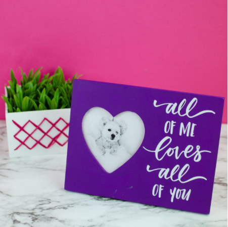 heart shaped photo frame with text saying All of me loves all of you