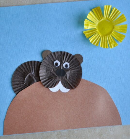 groundhog made from cupcake liners with cupcake liner sun and paper hill