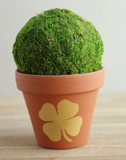 Flower pot with a metallic gold shamrock on the middle