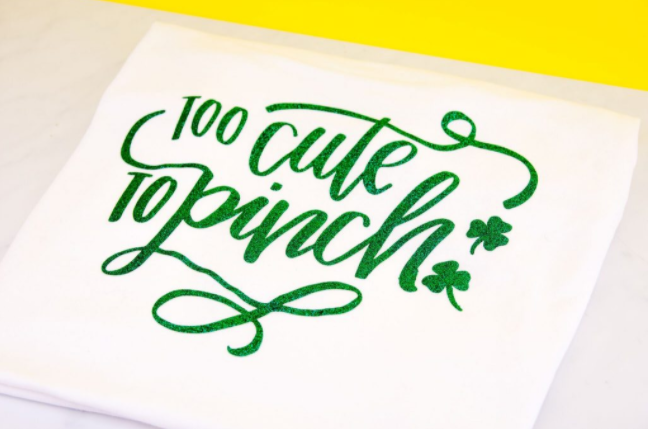 A St. Patrick's Day Iron On T- Shirt with a word says too cute to pinch